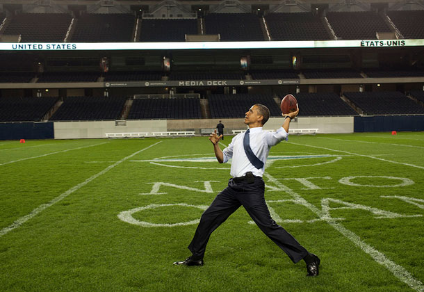 President Barack Obama throws a football on the field at Soldier Field following the NATO working dinner in Chicago, 2012. | Pete Souza, White House photographer