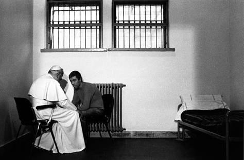 Pope John Paul II talks with Turkish gunman Mehmet Ali Ağca in a cell of Rome's Rebibbia prison on December 2, 1983.   Arturo Mari