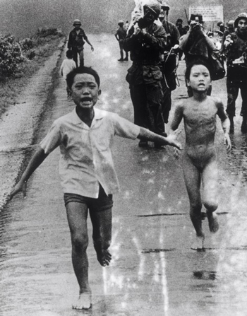Should A Photographer In Conflict Zones Help The True Story Of The Napalm Girl Image on old woman running scared