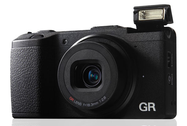 Ricoh GR -- small, light, relatively cheap and promising performance, what more you want?